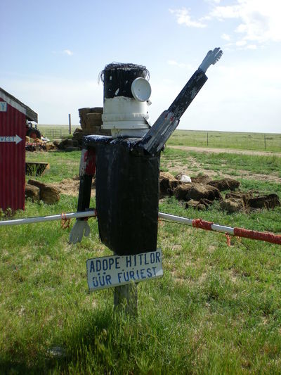 Colorado Junkyard Art Communication Day Field Grass Hitler ✌ Junkyard Nature No People Outdoors Satire Scarecrow Scrap Metal Sculpture Sky Text