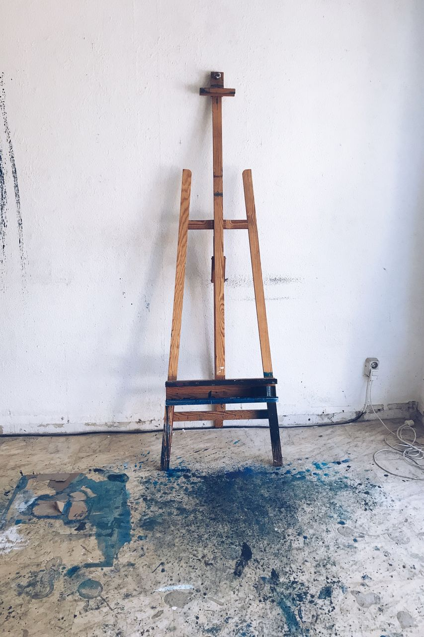 ladder, wall - building feature, step ladder, home interior, indoors, wood - material, no people, home improvement, built structure, architecture, destruction, day, paint roller