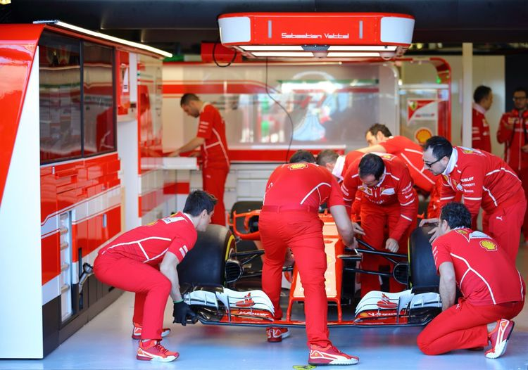 A capture of the Ferrari pit crew concentrated on the pre race setup of their F1 race car. Abstract Photography Concentration Eye4photography  EyeEm EyeEm Best Shots EyeEm Gallery EyeEmNewHere Ferrari Race Car Focus On Foreground Formula 1 Front Spoiler Garage High Performance Indoors  Melbourne F1 Grand Prix Motorsports Photography Pit Crew Race Car Race Car Setup Racing Pits Red Colour Skill  Teamwork Working As A Team