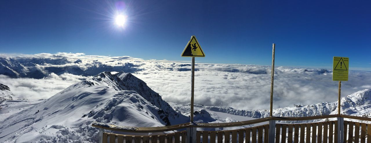 Panoramic View Of Snowcapped Mountains Amidst Clouds Against Sky