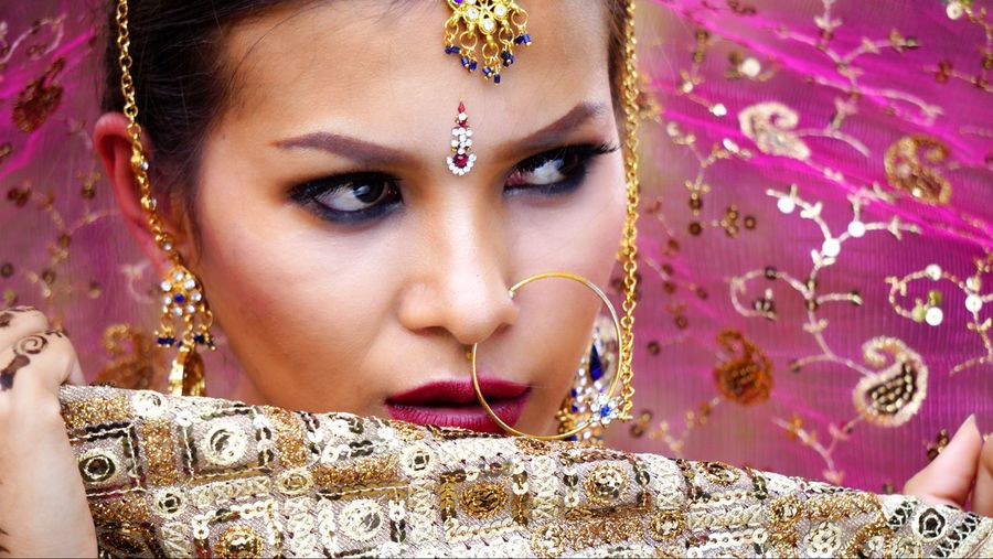 Bride Wearing Jewelries And Traditional Clothing At Park