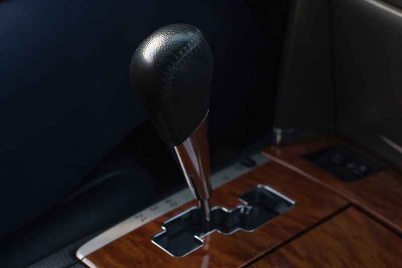 Gear shift in leather and wooden car interior Transport Transportation Driver Driving Stick Vehicle Interior Car Spead Gearshift Gear Roadtrip Leather