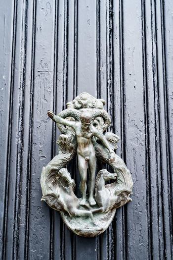 Close-up of old sculpture on wooden door