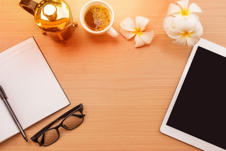 Book Close-up Coffee Cup Day Desk Diary Directly Above Drink Eyeglasses  Flower Food And Drink Freshness High Angle View Indoors  No People Note Pad Page Paper Pen Pencil Table Wood - Material