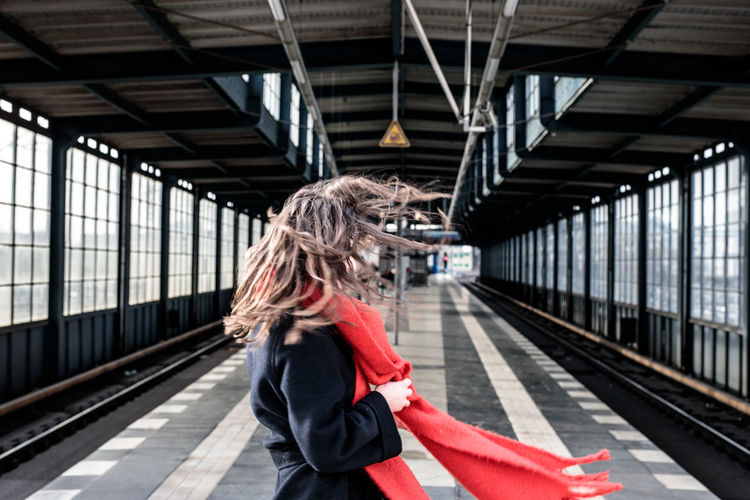 Woman standing on railroad station platform