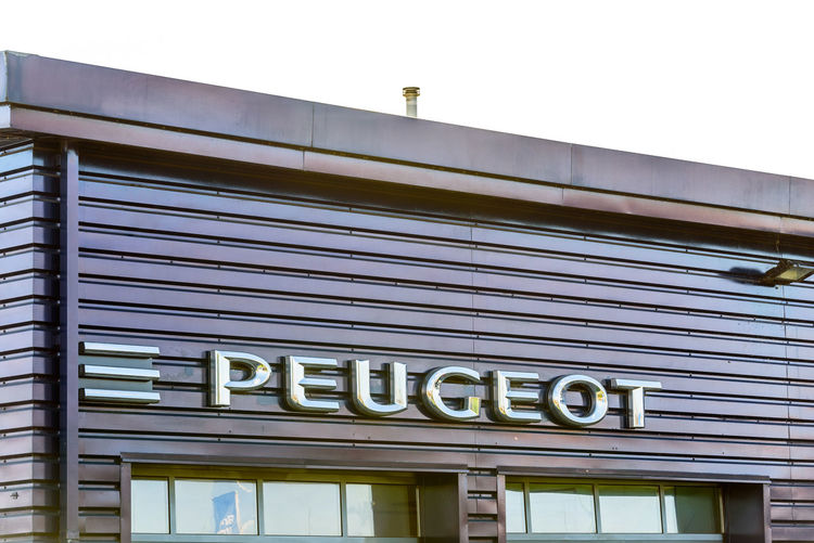 Day view of Peugeot logo at Riverside Retail Park Lion Logo Makeup Architecture Car Day Dealer Dealership No People Peugeot Sales Shop Silver