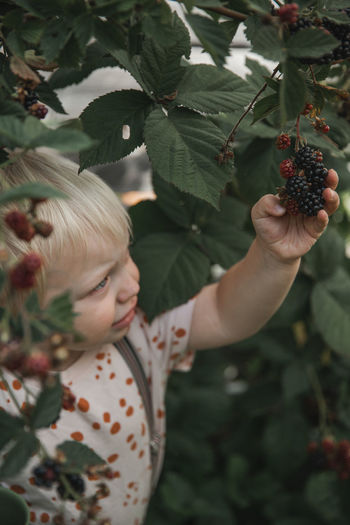 Full length of girl holding fruit