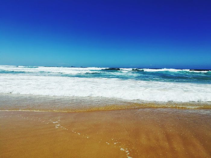 Sea Beach Blue Water Wave Sand Clear Sky Nature Beauty In Nature Purity Day No People Ocean Relaxing Outdoors Scenics Horizon Over Water Sky