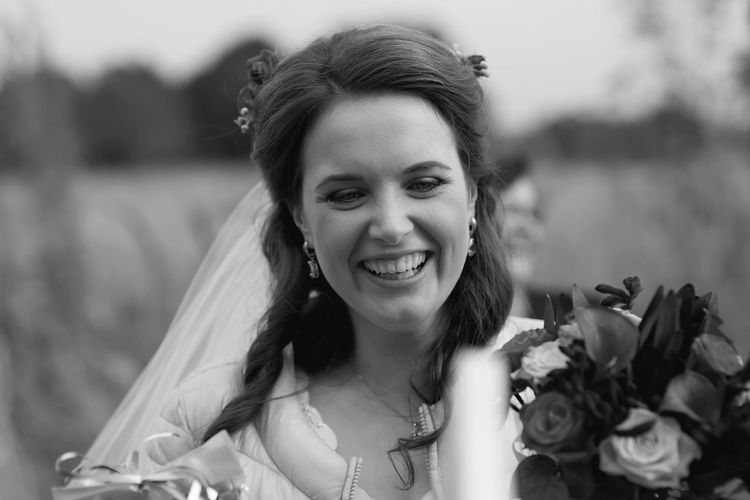 Beautiful Woman Blackandwhite Bride Close-up Day Flower Focus On Foreground Front View Happiness Headshot Long Hair Looking At Camera Nature One Person Outdoors People Portrait Real People Smiling Wearing Flowers Wedding Dress Young Adult Young Women