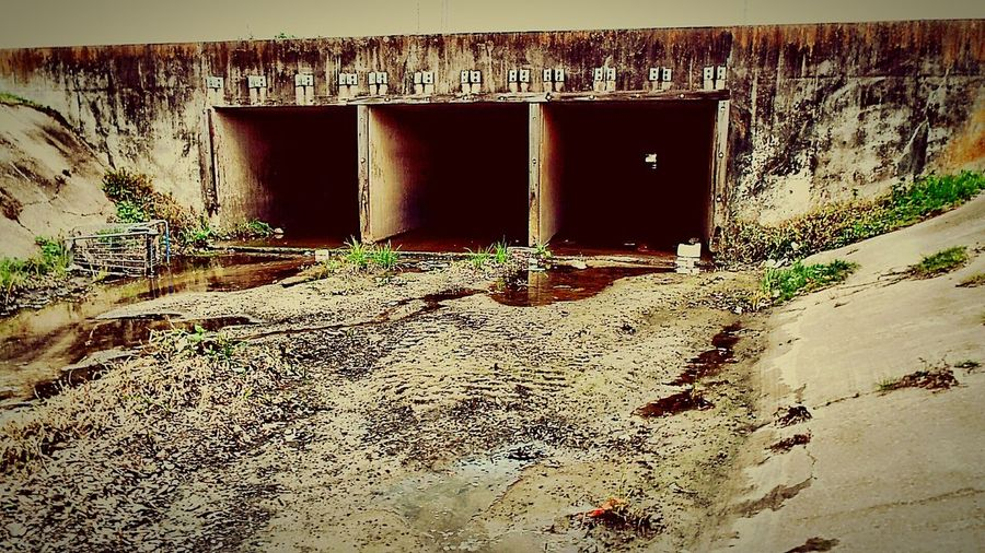 City Drainage System In The Ditch walking aping taking photos Walking Around Taking Pictures Gloomy Days Dusk Water