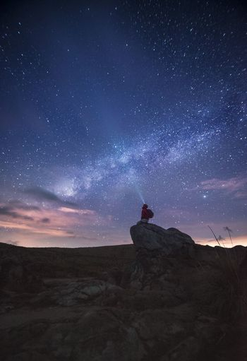 Lost In The Landscape Adult Adults Only Astronomy Beauty In Nature Desert Galaxy Landscape Nature Night One Man Only One Person Outdoors People Real People Scenics Silhouette Sky Space Standing Star - Space Tranquility See The Light