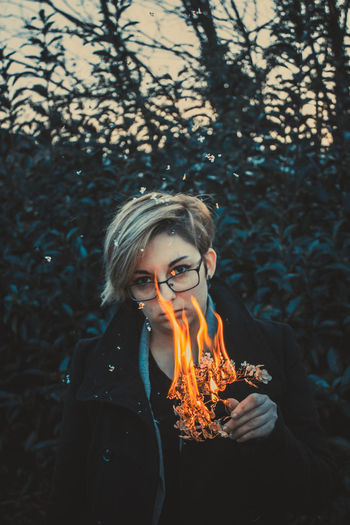 One Person Real People Fire Fire - Natural Phenomenon Front View Burning Young Adult Flame Leisure Activity Nature Heat - Temperature Tree Forest Blond Hair Portrait Waist Up Lifestyles Young Women Holding Hairstyle Outdoors Teenager Bonfire