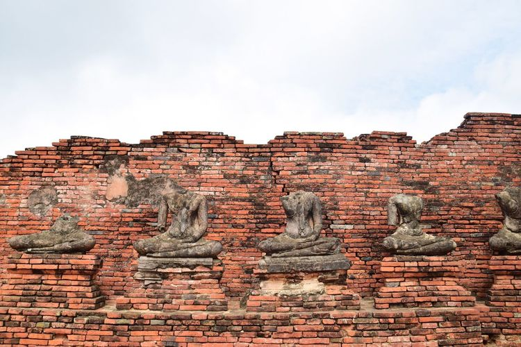 statue of buddha at historical park, Ayutthaya province, Thailand Wall View Copy Space Outdoors Background Buddha Ayutthaya Ayutthaya | Thailand Historic Histrorical Park Object Old Famous Place Visiting Travel Ayutthaya Historic Park Buddha Statue Trip Red Rock - Object Sky