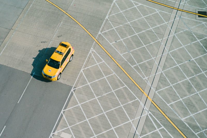 Transportation Yellow High Angle View Mode Of Transportation Land Vehicle Motion Road Taxi No People Day Airport Outdoors Yellow Taxi Travel Public Transportation on the move City Architecture Flooring Commercial Land Vehicle Dividing Line My Best Photo