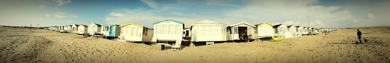 Beach Sand Ijmuiden Aan Zee In A Row Vacations Sea Sky Cloud - Sky Outdoors Travel Destinations Day Panoramic No People IJmuiden The Week On EyeEm Your Ticket To Europe Investing In Quality Of Life Summer Water Nature Architecture