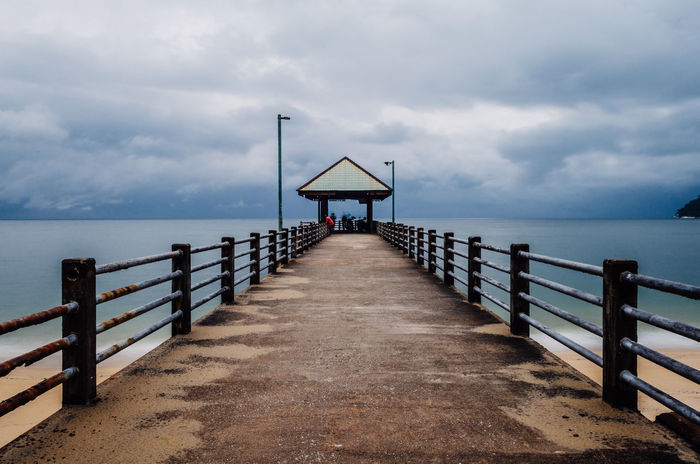 Cloudy Perspective Beach Beauty In Nature Built Structure Cloud - Sky Clouds And Sky Day Guidance Horizon Over Water Jetty Jetty View Nature No People One Point Perspective Outdoors Pier Railing Scenics Sea Sky The Way Forward Tranquil Scene Tranquility Water Connected By Travel
