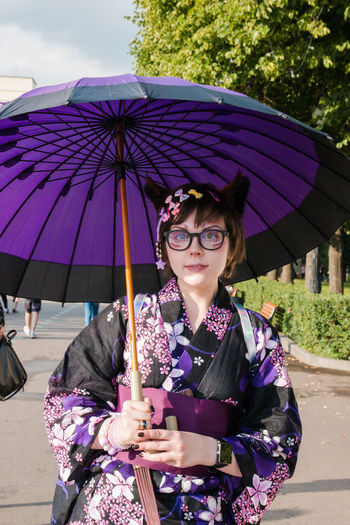 Japanese girl Beautiful Woman Clothing Fashion Front View Glasses Holding Leisure Activity Lifestyles Looking At Camera One Person Outdoors Portrait Protection Purple Rain Real People Security Standing Umbrella Waist Up Women Young Adult