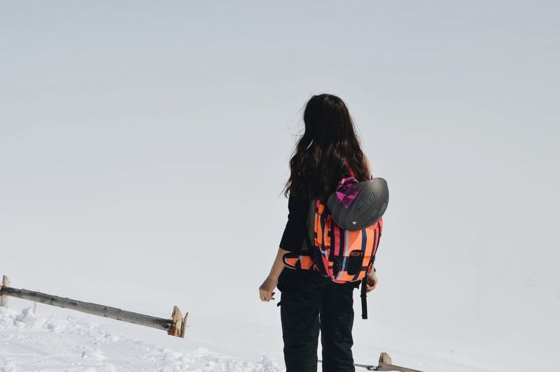 Long Hair Three Quarter Length Rear View One Person People Outdoors Young Adult Snow Adult Day Adults Only Sky Only Women Snowboarding An Eye For Travel Shades Of Winter