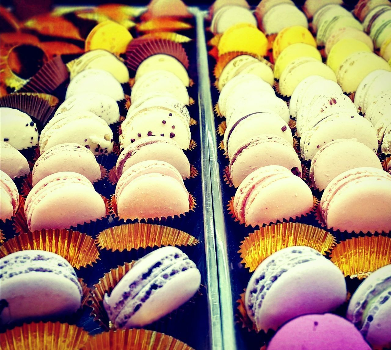 FULL FRAME SHOT OF CUPCAKES IN SHOP