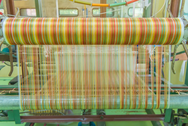 Indoors  Spool Industry Machinery Thread Manufacturing Equipment No People Factory Technology Food And Drink Industry Business Equipment Multi Colored Close-up Food And Drink Textile Still Life Textile Factory Large Group Of Objects Abundance