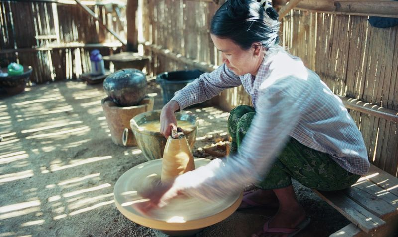 Only Women One Woman Only One Person People Adult Adults Only Sitting Preparation  Real People Women Outdoors Day Rural Scene Young Adult Pottery Shan State Traditional Myanmar Business Stories