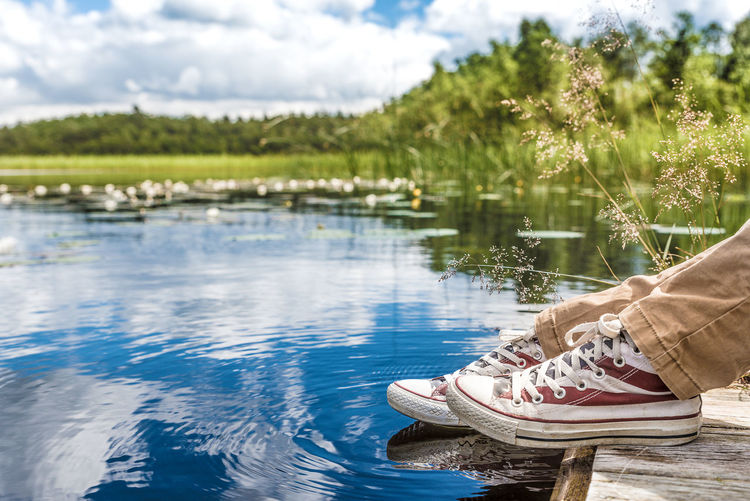 Probably too cold for a bath... Beauty In Nature Bridge By The Sea Cloud Cloud - Sky Converse Day Feet Focus On Foreground Idyllic Lake Lakeshore Nature Outdoors Reflection Scenics Shoes Sky Summer Views Summertime Tranquil Scene Trees And Sky Water Water Surface Youth