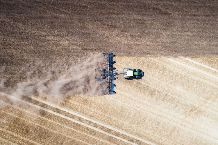 Cultivating the field. Land Sand Landscape Nature Agriculture No People Rural Scene Farm Crop  Environment Agricultural Machinery Cereal Plant Machinery High Angle View Harvesting