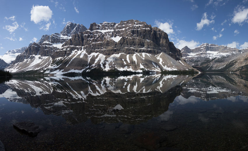 Bow lake banff Water Sky Tranquil Scene Scenics - Nature Mountain Tranquility Nature Winter Cloud - Sky Reflection Day Non-urban Scene Cold Temperature Environment Lake Snow Landscape No People Mountain Range Ice Outdoors Snowcapped Mountain Mountain Peak Bow Lake Reflections In The Water