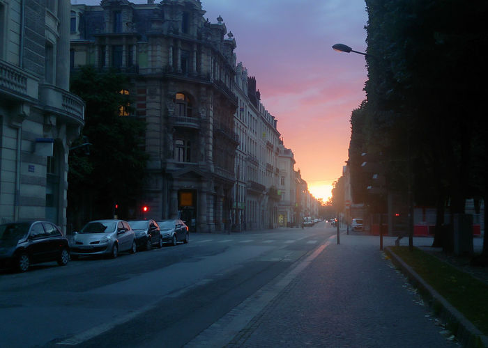 Ciel couchant à Lille.2014 City Transportation Motor Vehicle Architecture Car Building Exterior Street Sunset Built Structure Road Sky Direction City Street The Way Forward Outdoors City Life 2014 Lille France Nord Hauts De France Flandres  Cityscape Morning Europe