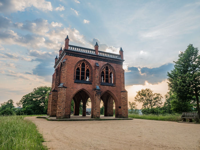 Neogothic Arbour in Babelsberg Park near Berlin Arch Architecture Architecture Building Exterior Built Structure Cloud Cloud - Sky Culture Day Façade Garden Gothic History Medieval Neogothic Outdoors Past Sky Sunset Sunset_collection Tourism Travel Destinations Tree Vacations