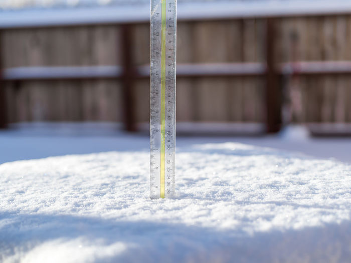 Plastic ruler measuring the snow depth after a recent snowstorm.