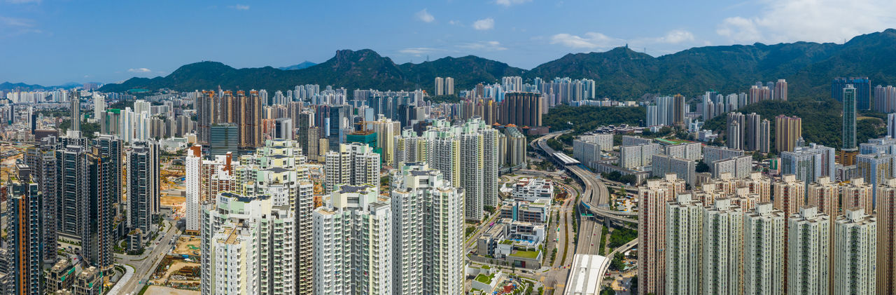 Top view of Hong Kong city Hong Kong Top View Hong Kong Building Kai Tak Kowloon Bay Side District Tall Apartment Real Estate Public House Lion Rock Mountain City Aerial Drone  Above Street Business Architecture Travel Urban Skyline Panoramic Landmark Tower Cityscape Helicopter ASIA Sky Fly Over Down Top Down Bird Eye Hk