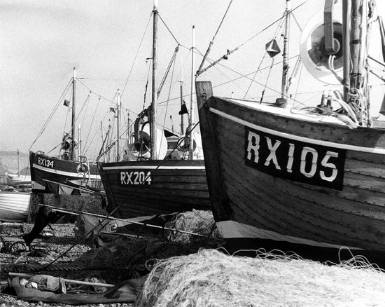 Fishing fleet, Hastings Beach, Suuses, UK Blackandwhite Photography Communication Day Fishing Boat Fishing Nets Harbor Moored Nautical Vessel No People Outdoors Rx105 Sea Sky Text Transportation Vintage Photo Water The World Before Bin Laden