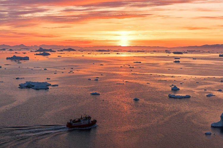 High angle view of boats in sea at sunset