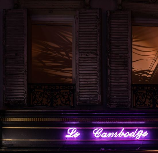 Le 🇰🇭. Illuminated Built Structure Architecture ParisByNight Night Lights Night Nightphotography Paris Paris, France  Paris ❤ Darkness And Light Shadow Shadows & Lights Palm Tree France Neon Neon Lights Window Cambodia Cambodge Plants Casting Shadows Streetphotography Traveling Travel Destinations
