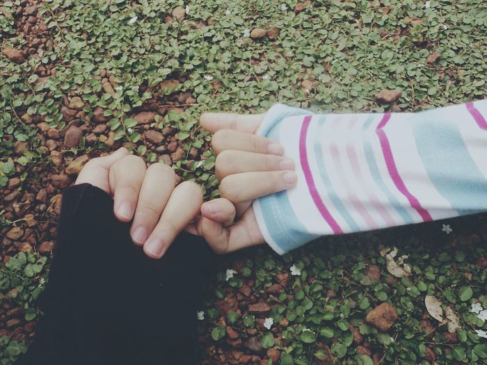 Love your friendship Friendship Friend Holding Hands Promise Love Care Human Hand Day Leaf Real People Bonding Close-up Outdoors EyeEm Ready