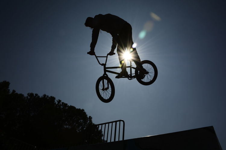 Freestyle biker Sport Skill  One Person Low Angle View Extreme Sports Leisure Activity Bicycle Competitive Sport People Freestyle Sports Freestyle Cycling Stunt Full Length Silhouette Shadow Skateboard Park Bmx Cycling Freestylebmx Freestyle Biking Welcome To Black