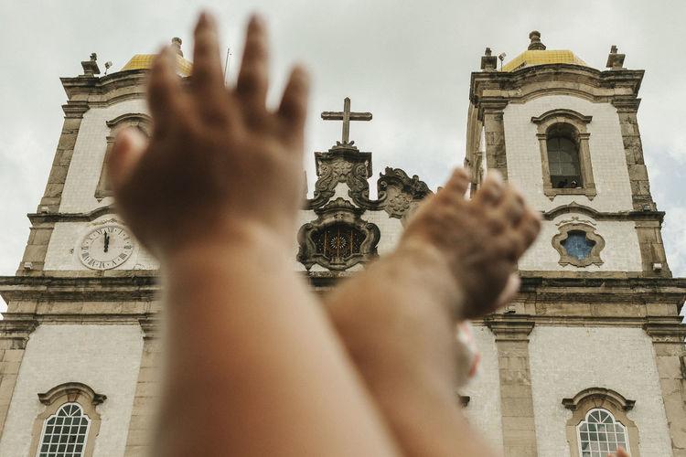 Cropped Hands Against Church Of Nosso Senhor Do Bonfim