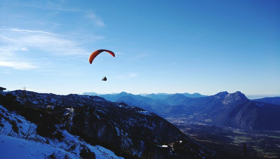 Extreme Sports Mid-air Flying Paragliding Mountain Adventure Parachute One Person Leisure Activity Headwear Sport Nature Sky People Jumping Outdoors Mountain Range Sports Helmet Landscape Scenics Austria Vacations Winter