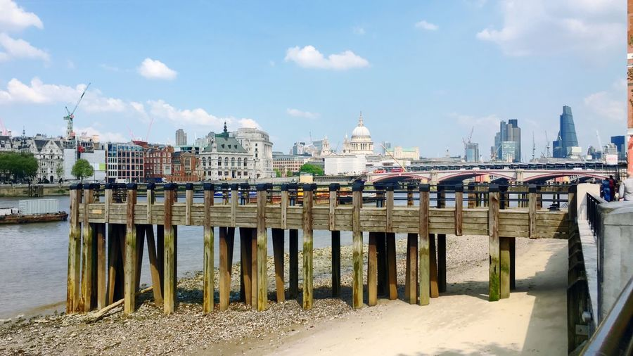 Jetty pier London skyline Thames river wood low tide outdoor daytime southbank