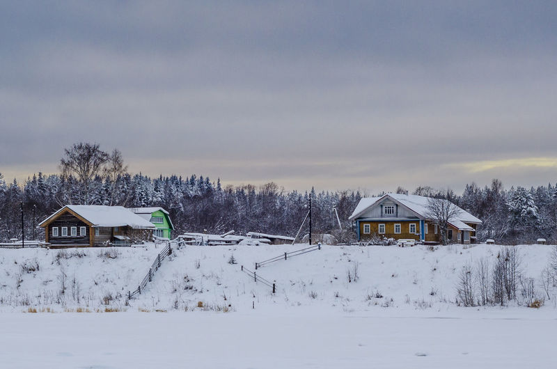 Snow Cold Temperature Winter Building Exterior Architecture Built Structure House Building Tree Nature Residential District Scenics - Nature Plant Beauty In Nature Sky Field Covering No People White Color Outdoors Snowcapped Mountain Cottage