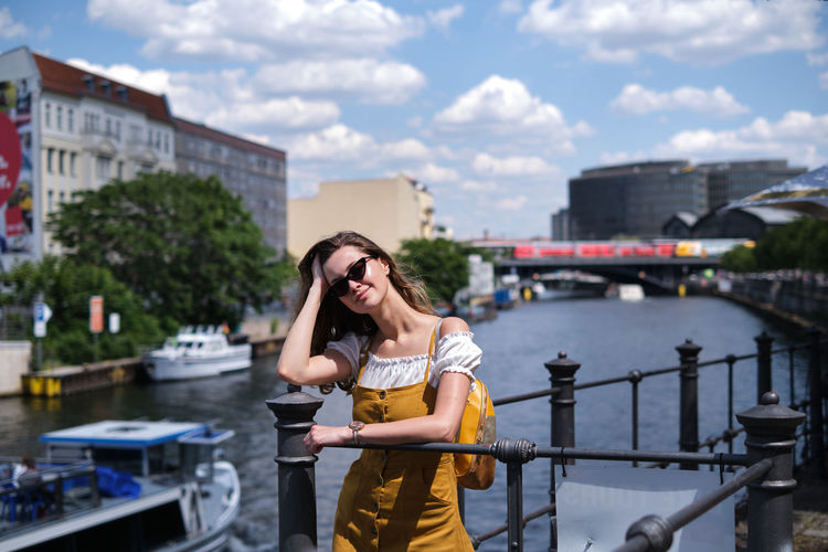 Full length of woman standing near a river in berlin