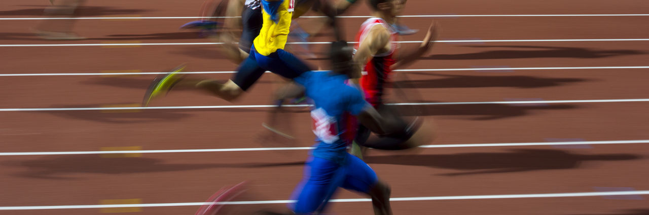 Blurred motion of athletes running on track
