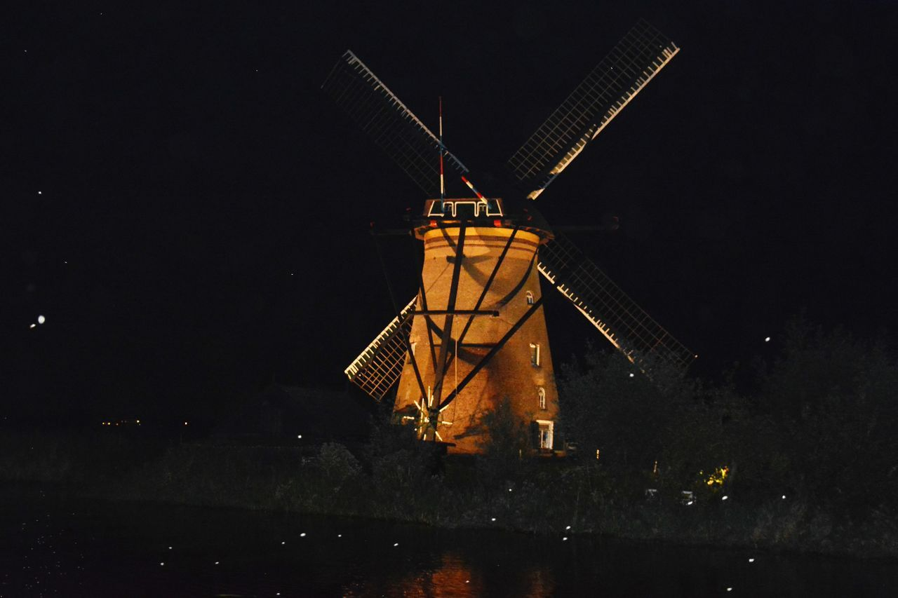 alternative energy, wind power, wind turbine, environmental conservation, renewable energy, windmill, fuel and power generation, traditional windmill, night, industrial windmill, built structure, outdoors, technology, architecture, no people, building exterior, illuminated, water, nature, sky