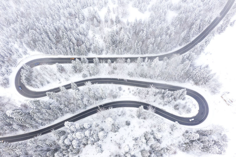 Beautiful road in Romania in a winter day. Snow Transportation Winter Mode Of Transportation Cold Temperature Tree Road Nature No People Day Car Outdoors High Angle View Extreme Weather Snowing Snowcapped Mountain Aerial View Drone  Dronephotography Transylvania Real People