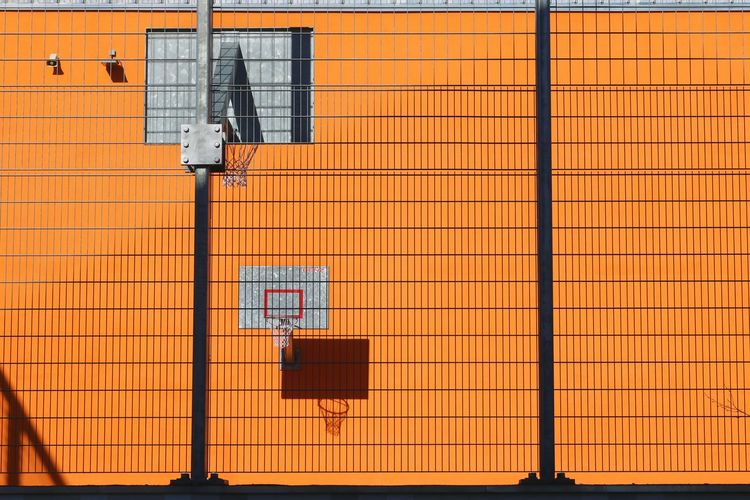 Low angle view of building against orange wall