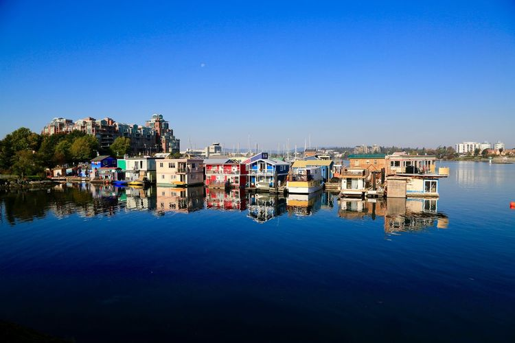 A peaceful view Water Reflection Clear Sky Blue Nautical Vessel No People Outdoors Architecture Built Structure Day
