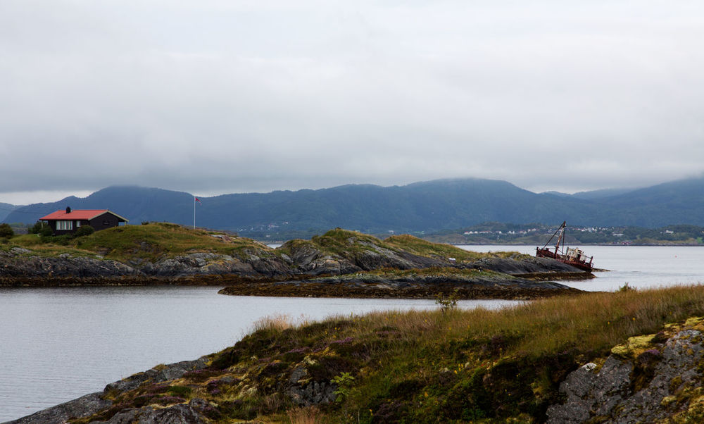 Landscape of Norway, Atlantic Ocean Road. Atlantic Road Eide Norway Travel Architecture Atlantic Ocean Road Bay Beauty In Nature Building Exterior Built Structure Cloud - Sky Day Lake Mode Of Transportation Mountain Mountain Range Nature Nautical Vessel No People Norway Nature Outdoors Scenics - Nature Sky Tranquil Scene Tranquility Transportation Water