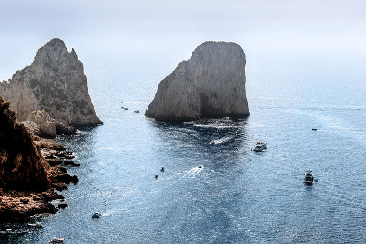 Water Sea Beauty In Nature Scenics - Nature Sky Day Tranquil Scene Nature Waterfront Tranquility Rock Land No People Rock - Object Rock Formation Beach Solid Idyllic Horizon Over Water Outdoors Stack Rock Faraglioni Italy Italia Capri