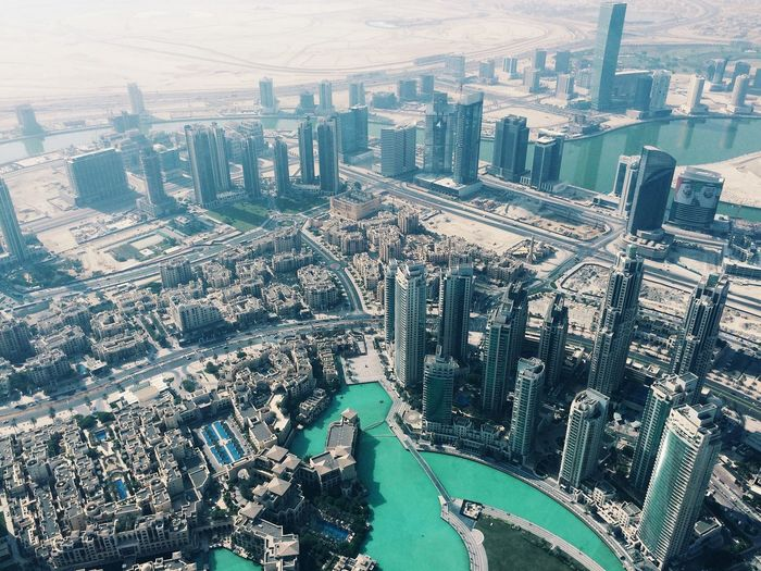 Aerial View Architecture Building Building Exterior Built Structure City City Life Cityscape Crowded Day Dubai Growth High Angle View Majestic Modern Outdoors River Sky Tower Travel Tree Water Waterfront